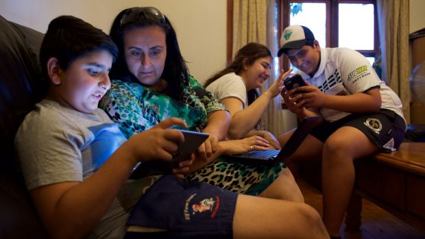 """""""Bring it on"""": Mary Boulos with her children (from left), Mikhael, Alyssa and Charvel, looks forward to the day when all ..."""