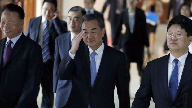 Chinese Foreign Minster Wang Yi, centre, waves to the media while on a visit to the Philippines this month.