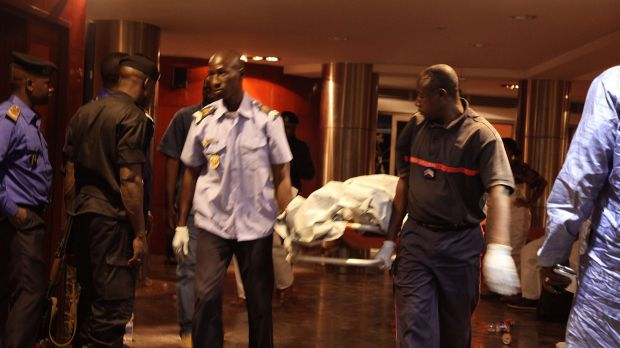 Mali security personnel remove the body of a victim from the Radisson Blu hotel after the attack that killed at least 21 ...