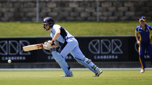 Tough cookie: Alyssa Healy made 65 not out for NSW after being hit on the head.
