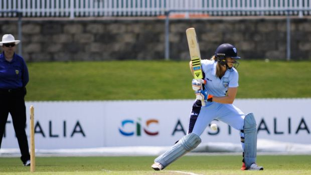 All-round talent: Ellyse Perry hits out for NSW.
