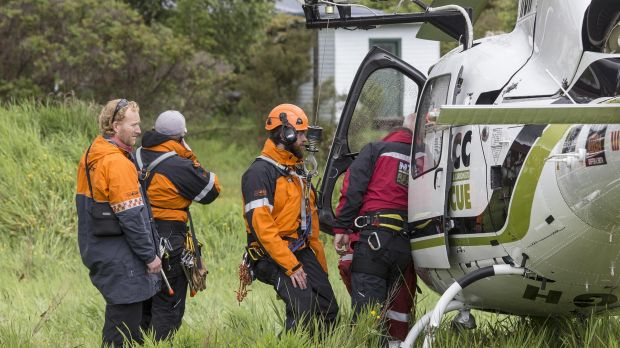 Rescue crew board a helicopter to head to the Fox Glacier valley where a helicopter crashed.