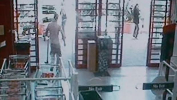 CCTV footage from Bunnings Warehouse shows a man leaving with a mattock in his left hand.