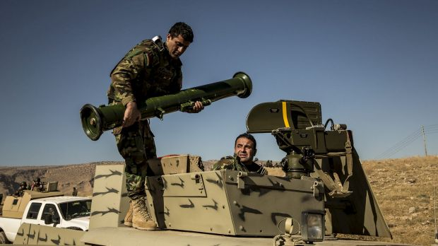 A peshmerga soldier mounting an antitank missile on top of a Humvee in Mount Sinjar, Iraq, late last year.