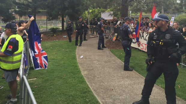 Police stand between the Reclaim Australia rally and counter rally.