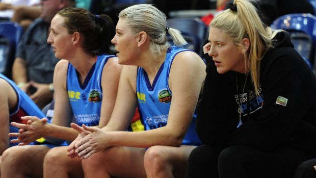 Right, Canberra Capitals player Lauren Jackson looks on from the bench.