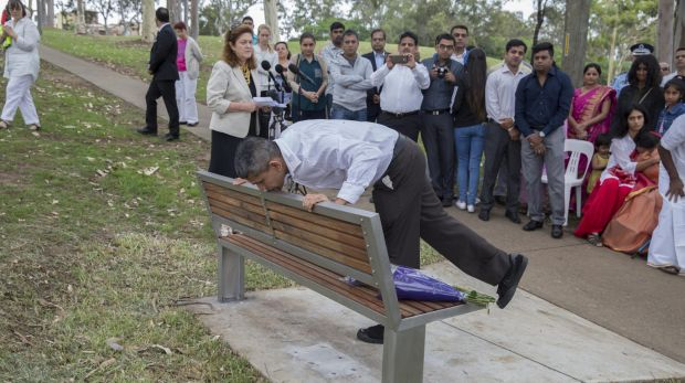 Prabha Kumar's brother, Shankar Shetty, kisses a memorial plaque for his slain sister in Parramatta Park during a ...