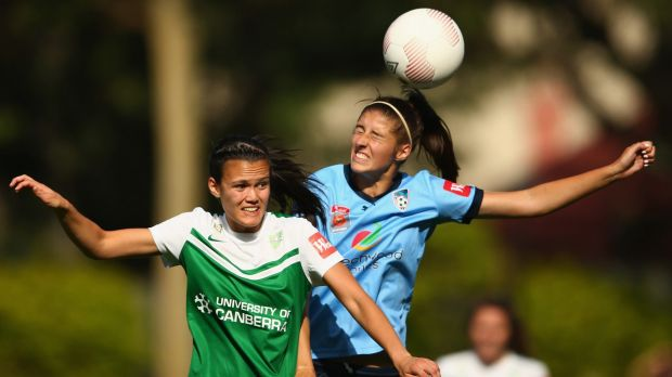 Canberra United defender Rebecca Kiting, left, puts pressure on Sydney FC's Amy Harrison during their 1-0 win earlier ...