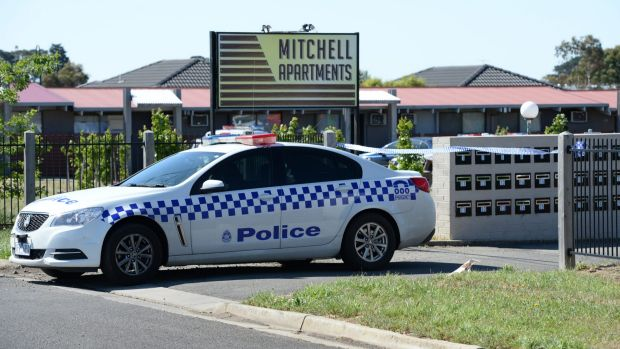 Police outside the Mitchell Apartments on Sunday.