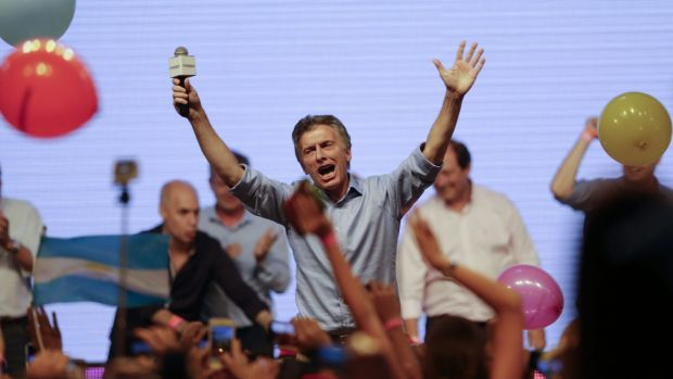 Opposition presidential candidate Mauricio Macri celebrates with supporters at his campaign headquarters in Buenos ...