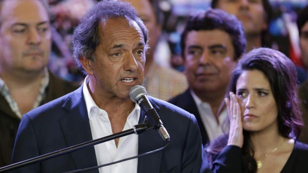 Daniel Scioli, the ruling party presidential candidate, delivers his concession speech as his daughter Lorena, right, ...