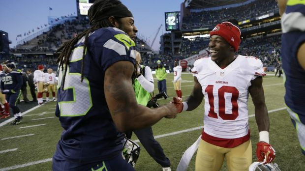 Friendly rivals: Seattle cornerback Richard Sherman greets San Francisco wide receiver Bruce Ellington after the ...