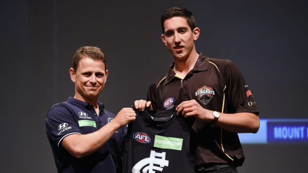 Carlton coach Brendon Bolton with the number one draft pick Jacob Weitering last year.