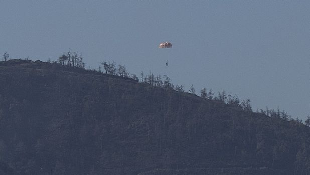 A pilot parachutes out of the warplane which went down in Syria's north-western Turkmen town of Bayirbucak.