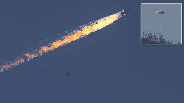 The Russian Su-24 crashes after being shot down by Turkish F-16s. Inset, a Russian pilot bails out near the Turkey-Syria ...