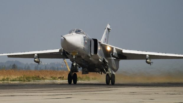 A Russian Su-24 takes off on a combat mission at Hemeimeem airbase in Syria.
