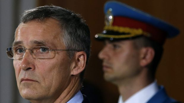 NATO Secretary General Jens Stoltenberg, left, will lead an emergency meeting in Brussels overnight following the ...