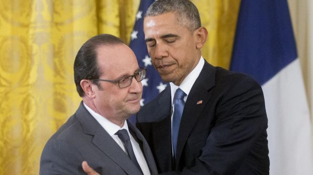 US President Barack Obama, right, greets French President Francois Hollande.
