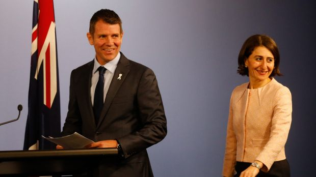 All smiles: NSW Premier Mike Baird and Treasurer Gladys Berejiklian last month. The budget half-yearly review detailing ...
