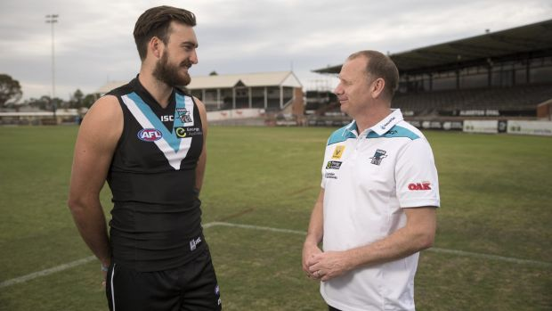 Charlie Dixon with Port Adelaide coach Ken Hinkley at Alberton Oval in Adelaide on Wednesday.