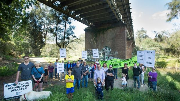 Alphington residents, pictured in October beneath the Chandler Highway bridge, are disappointed in VicRoads final plan ...