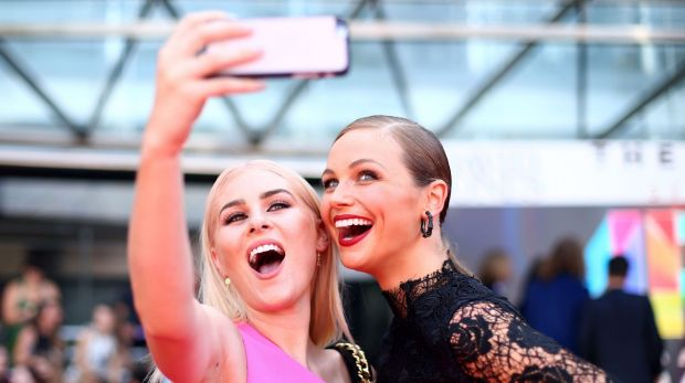 Carissa Walford and Ksenija Lukich take a selfie on the red carpet ahead of the ARIA Awards 2015 at The Star in November.
