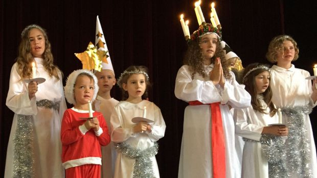 Children in the traditional Lucia procession for Saturday's Scandinavian Christmas Bazaar at Albert Hall.