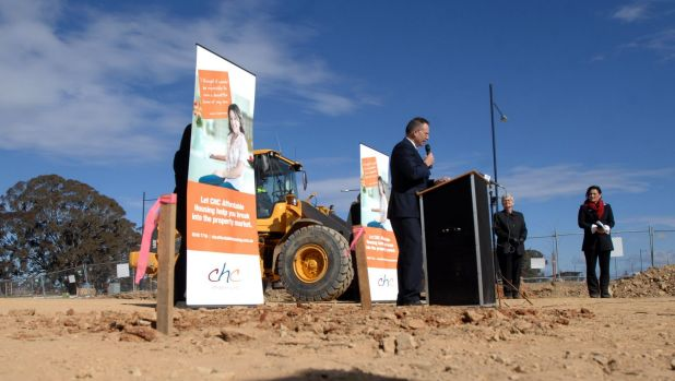 Flashback to August, 2009: Jon Stanhope turns the first sod on a block in Forde as part of the launch of stage two of ...