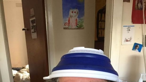 Church of the Flying Spaghetti Monster member Benjamin Ady wearing a colander on his head.