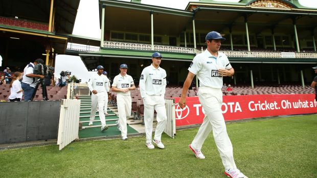 Paying respects: The Blues take to the SCG wearing black armbands.
