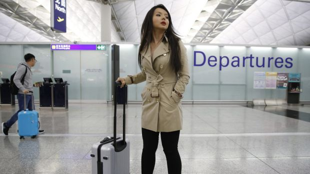 Canada's Miss World contestant Anastasia Lin poses for photographers after she was denied entry to mainland China, at ...