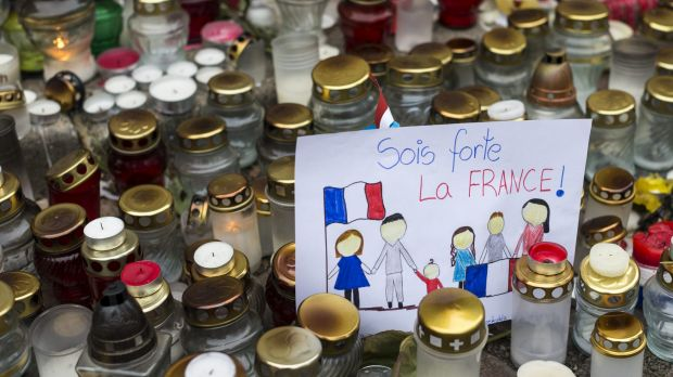 Candles and children's drawings outside the French embassy in Vilnius, Lithuania, for the victims of the Paris terror ...