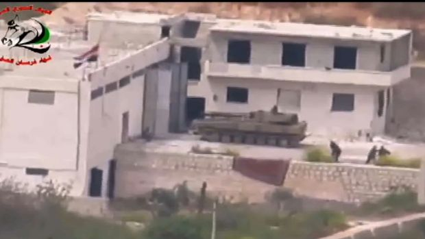 Footage supplied by the Free Syrian Army's Fursan al-Haq Brigade shows a Syrian tank near Ariha, in Syria's Idlib ...