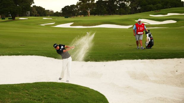 Local knowledge: Matt Jones blasts out of a fairway bunker on the 18th hole.