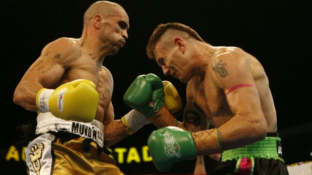 Squaring up: Green and Mundine in their 2006 showdown.