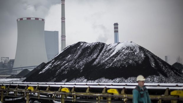 Brown coal stockpiles and a power station in the Czech Republic.