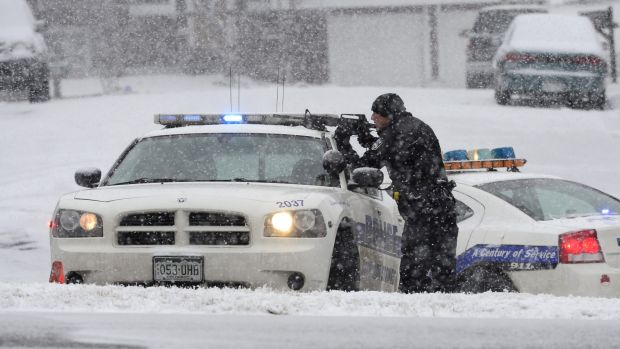 An officer ready to shoot after reports of a shooting near a Planned Parenthood clinic in Colorado Springs on Friday.