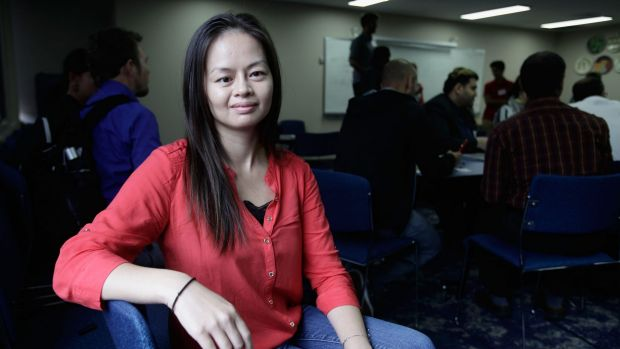 Former refugee now successful startup entrepreneur Shelli Trung is a mentor and judge in a hackathon for refugees.