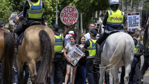 Anti-racism protesters during simultaneous rallies outside State Parliament.