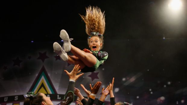 What a throw ... performing at the cheerleading competition.