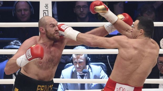Battle of the big men: Ukraine's Wladimir Klitschko, right, and Britain's Tyson Fury exchange blows in their world ...