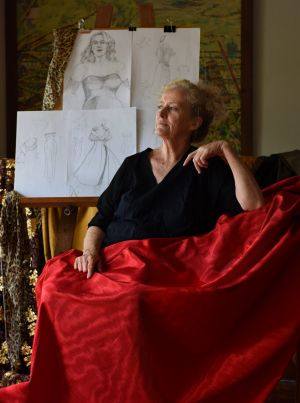 Margot Wilson ... dressmaker behind <i>The Dressmaker</i> with sketches and the fabric used for one of Kate Winslet's ...