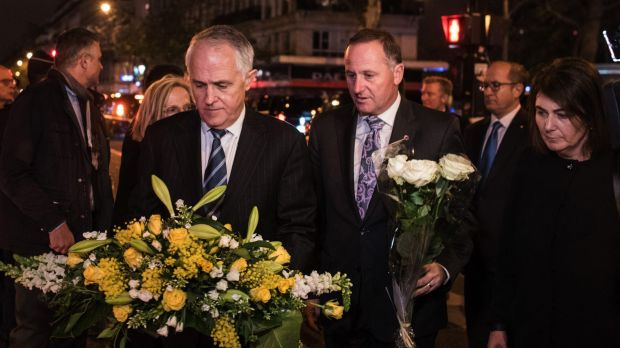 Australian Prime Minister Malcolm Turnbull joins New Zealand's John Key to lay flowers for victims of the Paris terror ...