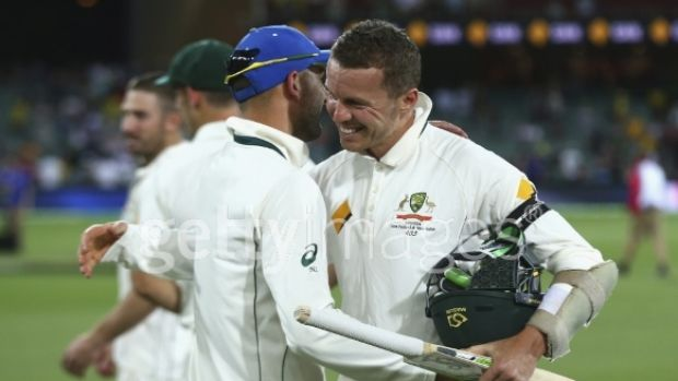 Peter Siddle and Nathan Lyon of Australia celebrate the win.