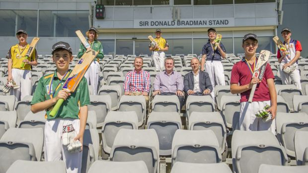 Brad Haddin presented seven ACT centurions with medals on Monday, and Owen Levings, front left, made the former ...