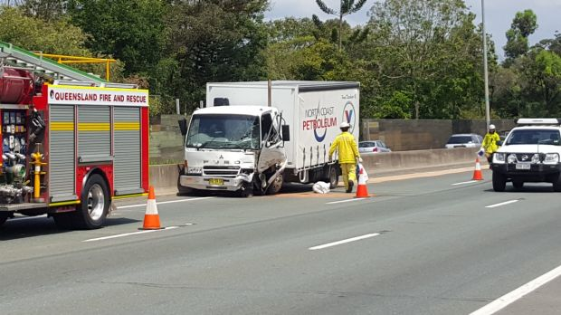 A damaged truck following an accident in the northbound lanes of the Pacific Motorway, south of the Gateway Motorway exit.