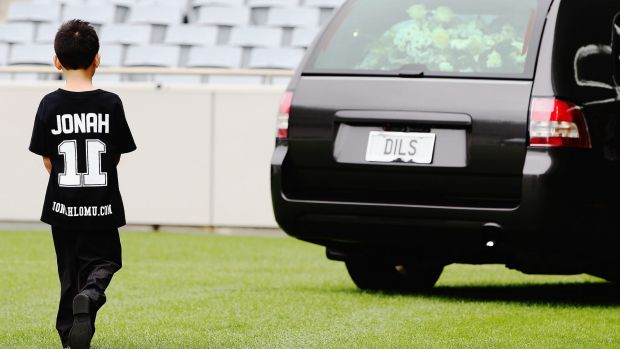 Jonah and Nadene's son Dhyreille Lomu follows the hearse as it departs the Public Memorial for Jonah Lomu at Eden Park ...