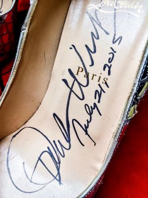 The billionaire, 61, also signed the eye-catching designer shoes, size 41.