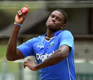Jason Holder, the captain of the West Indies cricket team, bowls during a practice session in Brisbane.