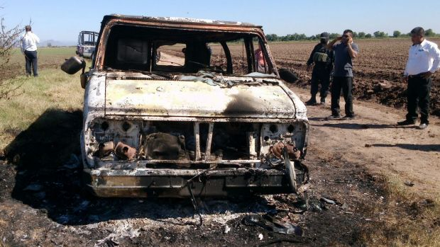 The burnt-out van registered to missing Australian surfer Adam Coleman.